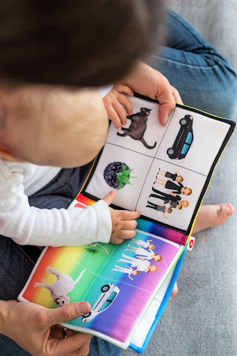 AAC device infant and parent reading book